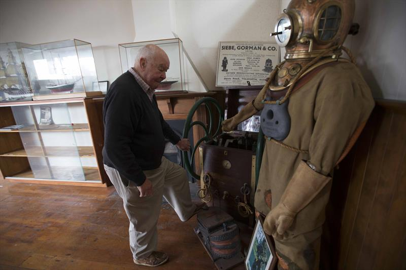 John Street looks over a deep sea diving suit used in a lot of salvage and other underwater tasks - photo © NZ Maritime Museum