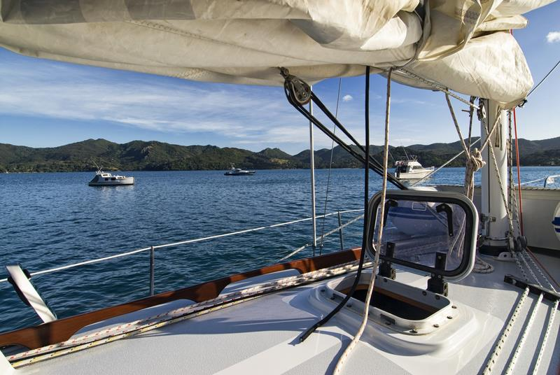 Morning view of a yacht anchored at Great Barrier Island. Protecting our pristine spots is something we can all help with.  - photo © Auckland Council