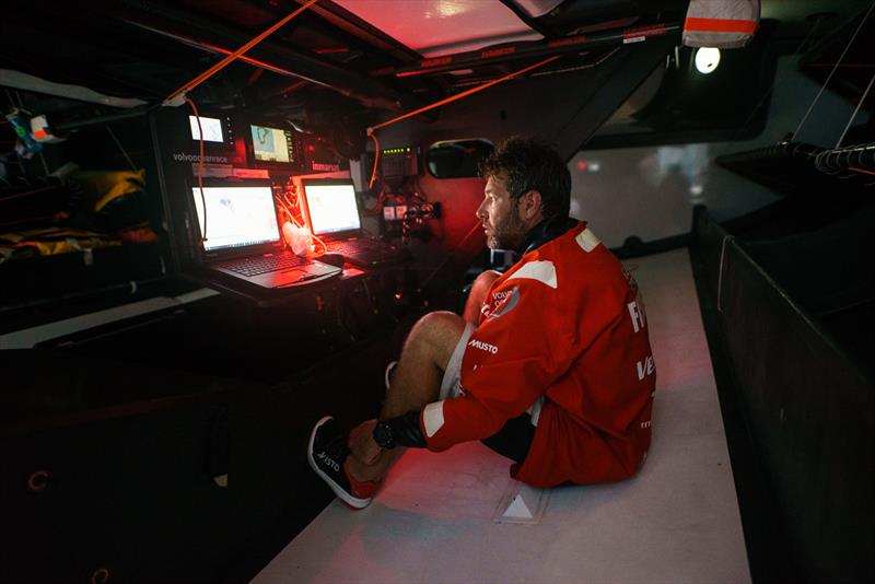 Leg 4, Melbourne to Hong Kong, day 13, Simon Fisher \`SiFi\` sits in the bilge after swinging his nav station on board Vestas 11th Hour to the high side for a quick gybe to clear an atoll. - photo © Amory Ross / Volvo Ocean Race